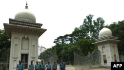 Bangladeshi police personnel stand guard at the Supreme Court premises in Dhaka on May 11.