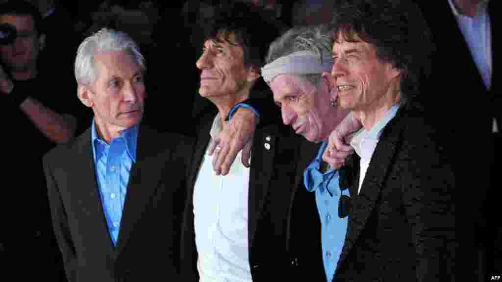 """The Rolling Stones pose on a red carpet on London's Leicester Square on October 18as they arrive for the premiere of """"Crossfire Hurricane,"""" a documentary about the rock group. (AFP/Carl Court)"""