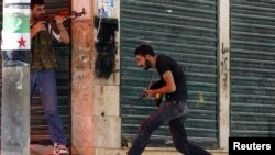A Free Syrian Army fighter runs for cover during clashes with Syrian Army soldiers in Aleppo's Salaheddine district on August 5.