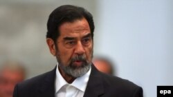 Saddam Hussein addresses the court during his trial in Baghdad in November 2006