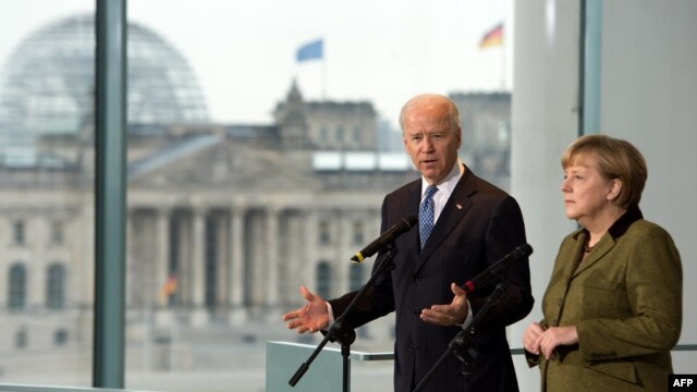 German Chancellor Angela Merkel and U.S. Vice President Joe Biden talk to journalists at the chancellery in Berlin.