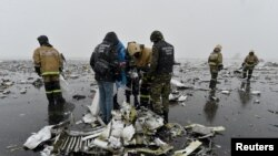 Russian Emergency Situations Ministry officers and investigators work at the crash site of the Boeing 737-800 Flight FZ981 operated by Dubai-based budget carrier FlyDubai at the airport of Rostov-On-Don on March 19.