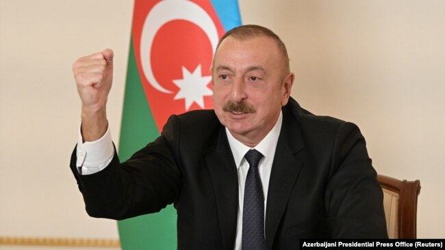 Azerbaijani President Ilham Aliyev gestures as he speaks during an address to the nation in Baku on October 26.