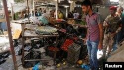 Ал-Шааб базарындагы жардыруудан кийинки көрүнүш. 17-май, 2016-жыл. Багдад.