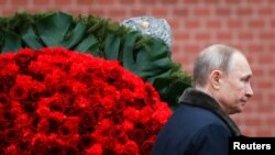 Moscow, Russia - Russian President Vladimir Putin attends a wreath-laying ceremony at the Tomb of the Unknown Soldier, near the Kremlin during the national celebrations of the 'Defender of the Fatherland Day'