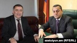 Armenia -- Parliament deputies Arayik Grigorian (R) and Murad Muradian.