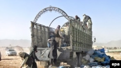 Workers unload drugs after they were seized in Kandahar in October 2008