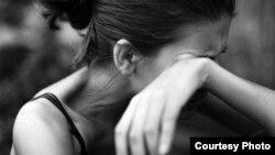 Женщина, подвергашаяся домашнему насилию. Иллюстративное фото.