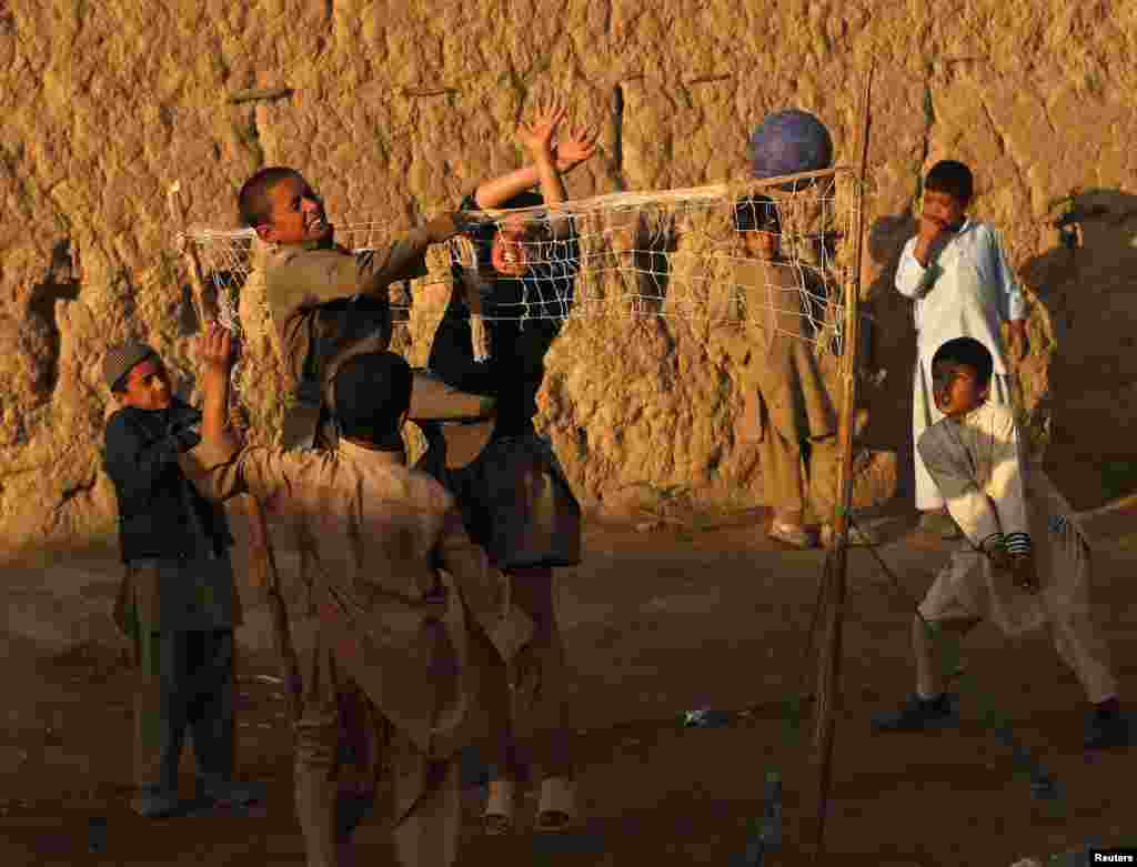 Afghan boys play volleyball on the outskirts of Kabul. (Reuters/Mohammad Ismail)