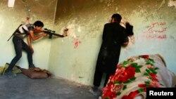 Алеппоның Карм әл-Жабал ауданындағы жанжал кезінде. Сирия. 23 шілде, 2013 жыл.