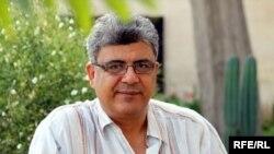 الإعلامي العراقي علي عبد الأمير