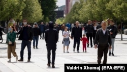 KOSOVO -- Pedestrians walk during the first week of the reopening of the main square in Pristina, MY 27, 2020