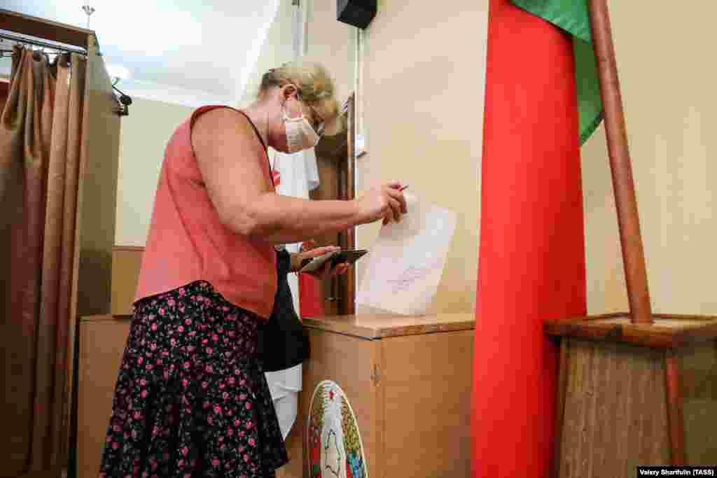 A woman casts her ballot at a polling station in Minsk.