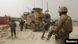 U.S. soldiers keep watch at the entrance of the U.S. base in Panjwai district of Kandahar Province.
