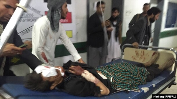 Wounded arrive at a hospital in Balkh.