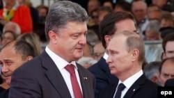 Ֆրանսիա - Ռուսաստանի և Ուկրաինայի նախագահները Երկրորդ աշխարհամարտում դաշնակիցների զորքերի ափհանման 70-ամյակի հանդիսությունների ժամանակ, 6-ը հունիսի, 2014թ․