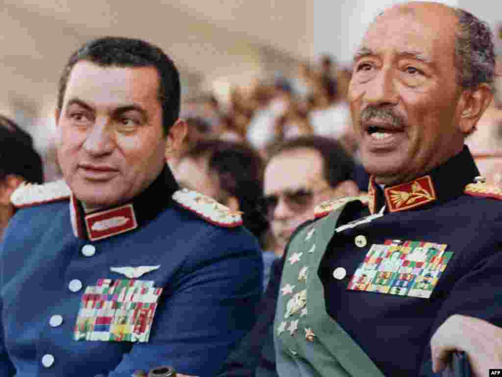 Egyptian vice president at the time, Mubarak with the late President Anwar Sadat. - Both dressed in military honor uniforms, Mubarak and Sadat attend a military parade on October 6, 1981, in Cairo during which Sadat was assassinated by a group of Islamist fundamentalists.