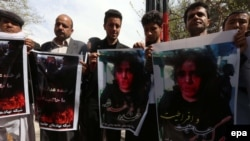 Afghan civil-society activists hold placards during a protest against the killing of Farkhanda in Herat on March 23.