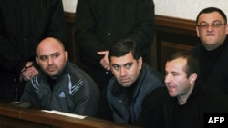 Former Defense Minister Irakli Okruashvili (second from left) sits in a Tbilisi court on December 10.