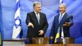 Президент України Петро Порошенко (ліворуч) і прем'єр-міністр Ізраїлю Беньямін Нетаньягу під час прес-конференції за підсумками підписання Угоди про зону вільної торгівлі між Україною та Ізраїлем. Єрусалим, 21 січня 2019 року