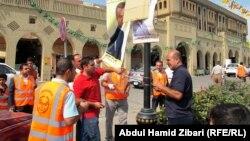 بلدية أربيل تزيل ملصقات إنتخابية