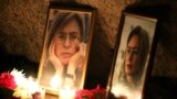 RUSSIA -- Flowers and candles lie on the Solovetsky Stone to mark the 13th anniversary of assassination of journalist Anna Politkovskaya, St. Petersburg, October 7, 2019