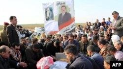 Janyna kast edilen syýasatçy Mohammed al-Jubouriniý jaýlanyş çäresi, Kirkuk, 2-nji dekabr, 2015