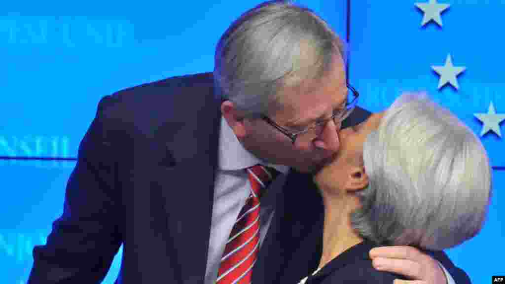 Eurogroup President Jean-Claude Juncker kisses International Monetary Fund Managing Director Christine Lagarde after a press conference in Brussels to announce a deal on a Greek bailout on February 21. (AFP PHOTO/GEORGES GOBET)