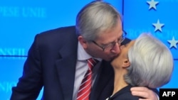 Eurogroup President Jean-Claude Juncker kisses International Monetary Fund (IMF) Managing Director Christine Lagarde after a press conference in Brussels on February 21 announcing the terms of the Greek bailout, the second in under two years.
