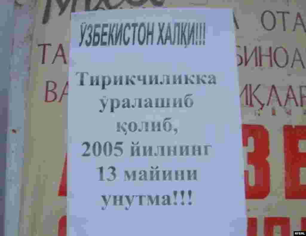 "A flyer at the main market in the Kyrgyz border town of Kara-Suu one year after the violence reminds readers in Uzbek: ""People of Uzbekistan! Amid [your] daily routine, don't forget May 13, 2005!"" - The EU sanctions against Uzbekistan -- and whether to renew, drop, or possibly expand them -- are presently under discussion by EU ministers. A decision is expected on May 14. (Photos RFE/RL, AFP, and ITAR-TASS; text by Breffni O'Rourke)"