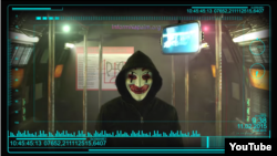 "A video published on YouTube, showing a masked Ukrainian ""hacktivist"", announces the operation by Ukrainian hacking groups Falcons Flame and Trinity in May against the websites of the Russia-backed separatist group Donetsk People's Republic."