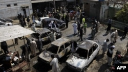 Pakistan -- Pakistani security officials inspect the site of a suicide bombing in Shabqadar, March 7, 2016