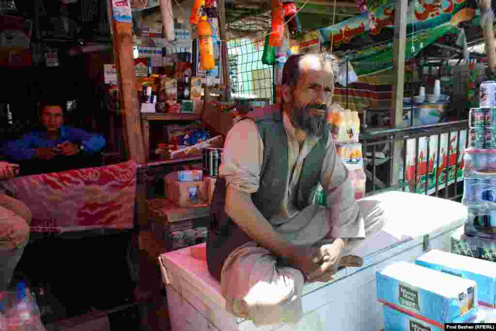 Halim rents out a stall at Bagram Bazaar. He worked at the base for seven years before being fired earlier this year.