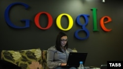 A woman works on a laptop at a Google facility in Moscow. (file photo)