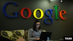An employee works on a laptop at Google's headquarters in Moscow. (file photo)