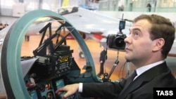 Russian President Dmitry Medvedev sits in the cockpit of a fighter jet during a visit to a jet manufacturing plant in Irkutsk.