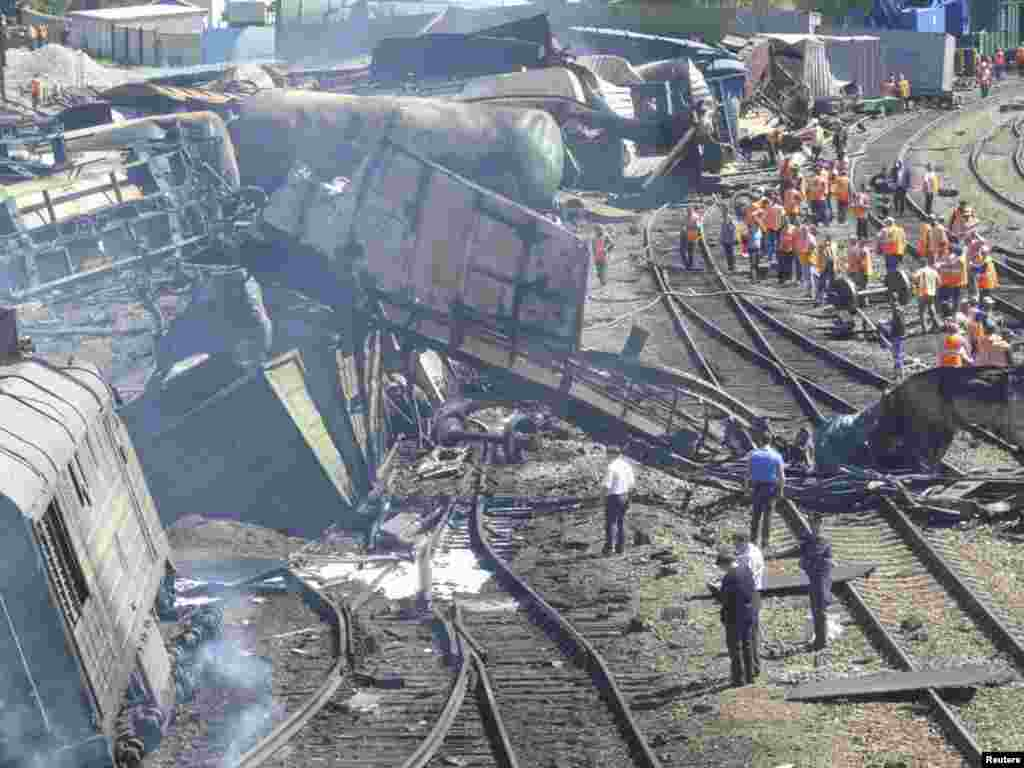 Emergencies Ministry staff work at the site of an explosion in the Belaya Kalitva station in the southern Russian region of Rostov-on-Don. The explosion on a freight train carrying chemicals and oil products hurled part of a railcar into a residential block, injuring 27 people. (Reuters)