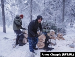 Boleslav Vavilov collects firewood -- the only source of heating in the monastery.