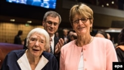 Veteran Russian human rights defender Lyudmilla Alekseyeva and co-founder of the Moscow Helsinki Group (L) receives the third Vaclav Havel Human Rights Prize from Anne Brasseur (right), the President of the Parliamentary Assembly of the Council of Europe (PACE), in Strasbourg late last year.