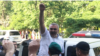 Afqan Muxtarli waves to supporters in Baku on May 30.