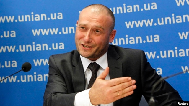 Ukraine's ultranationalist Right Sector group has poured scorn on allegations that the business card of one of its leaders Dmytro Yarosh (pictured) was found at the scene of a shoot-out near Slovyansk. It seems a large portion of the Internet community has also scoffed at the claim. (file photo)