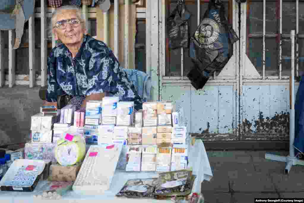 A woman sells Russian cigarettes in downtown Sukhumi. The Russian ruble is Abkhazia's de facto currency.