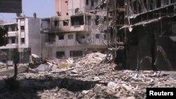 Қақтығыстан қираған Хомс қаласы. 16 шілде 2012 жыл. Көрнекі сурет.