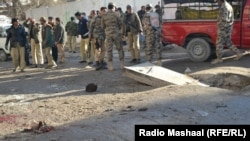 Pakistani security officials examine the site of a bomb blast near a polio vaccination center in Quetta on January 13.
