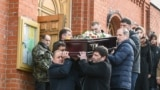 RUSSIA -- Men carry the coffin of a victim of a shopping mall fire out of a church during a funeral service in the industrial city of Kemerovo in western Siberia, March 28, 2018