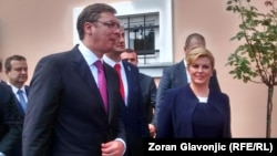 Serbian Prime Minister Aleksandar Vucic (left) and Croatian President Kolinda Grabar-Kitarovic gave the impression of performing a mildly unpleasant but unavoidable duty, doing their best to project an image of harmony and friendship.