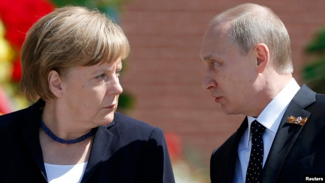 "German Chancellor Angela Merkel (left) said she maintains ""regular contact"" with Russian President Vladimir Putin for the sake of resolving conflicts like that in Syria."