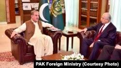 Pakistani Foreign Minister Shah Mahmood Qureshi (left)meets with U.S. envoy Zalmay Khalilzad in Islamabad on December 13.