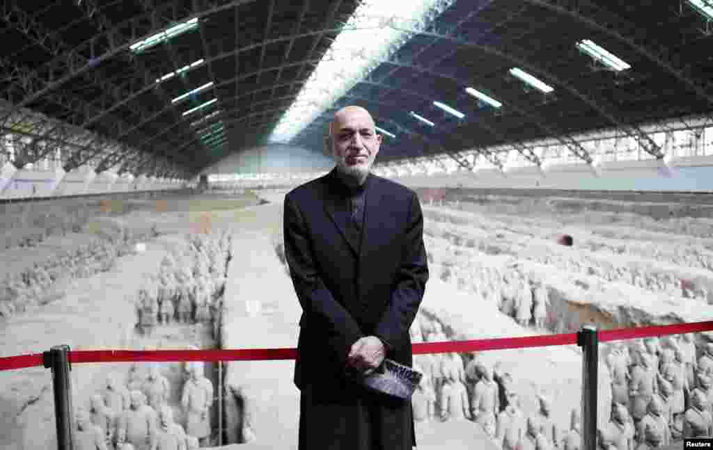 Afghan President Hamid Karzai poses for photographs during a visit to the Museum of Qin Terracotta Warriors and Horses in Xi'an, in China's Shaanxi province. (Reuters/China Daily)