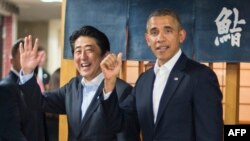 U.S. President Barack Obama (right) being greeted by Japanese Prime Minister Shinzo Abe after arriving in Japan on April 23